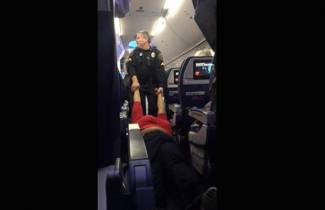 Woman Is Dragged by Limbs Off Delta Airlines Flight in Detroit After Displaying 'Huge Attitude'