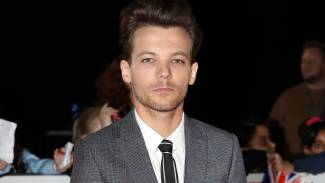 Louis Tomlinson Arrested for Attacking a Paparazzo